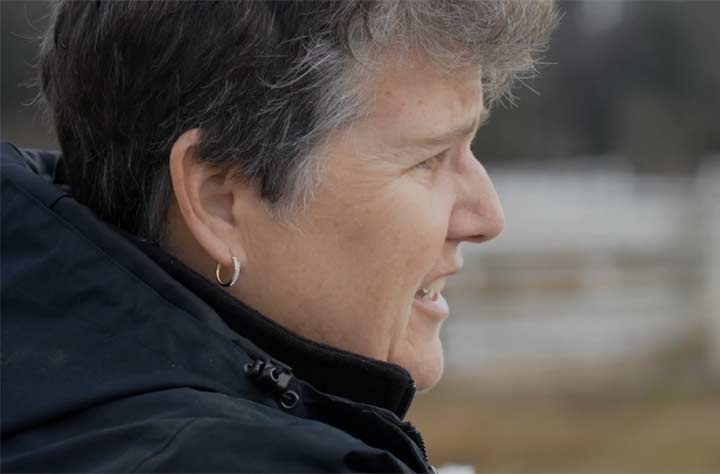 Catherine Baker looking out onto the horses at the equestrian center.