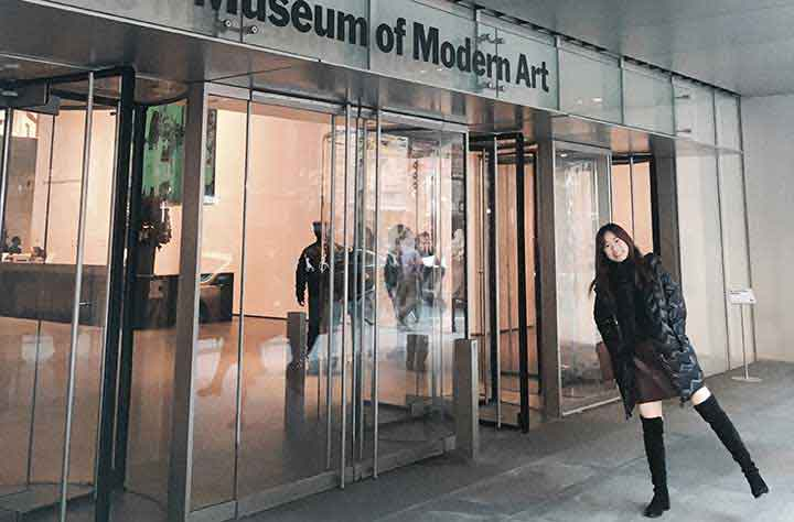 Student Jing (Bliss) Lan stands in from of Museum of Modern Art