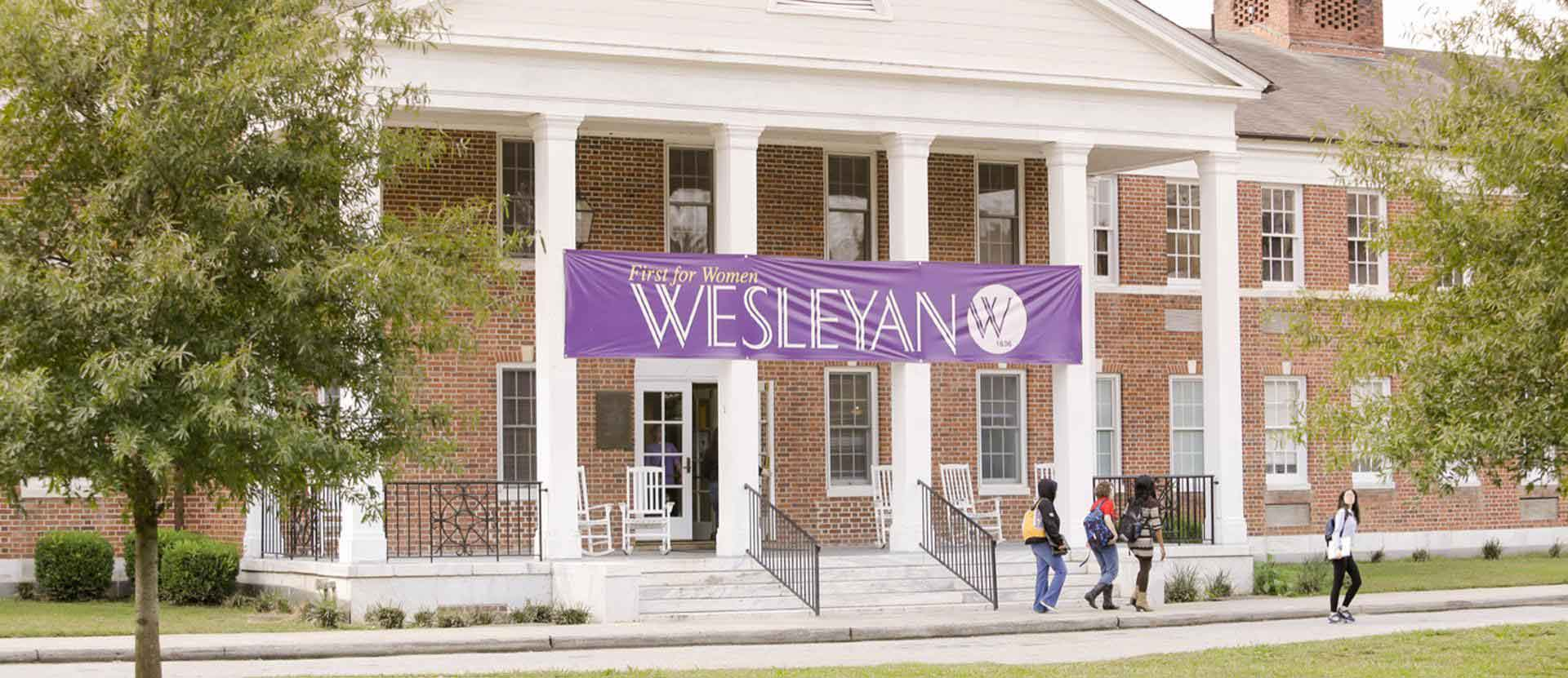 OSP main building with Wesleyan banner hung across the front