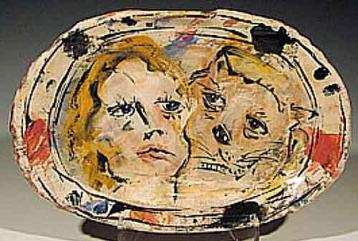 Picture of one of Ron Meyers platers with two faces drawn on it.