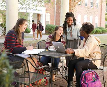 Students outside during a study session.