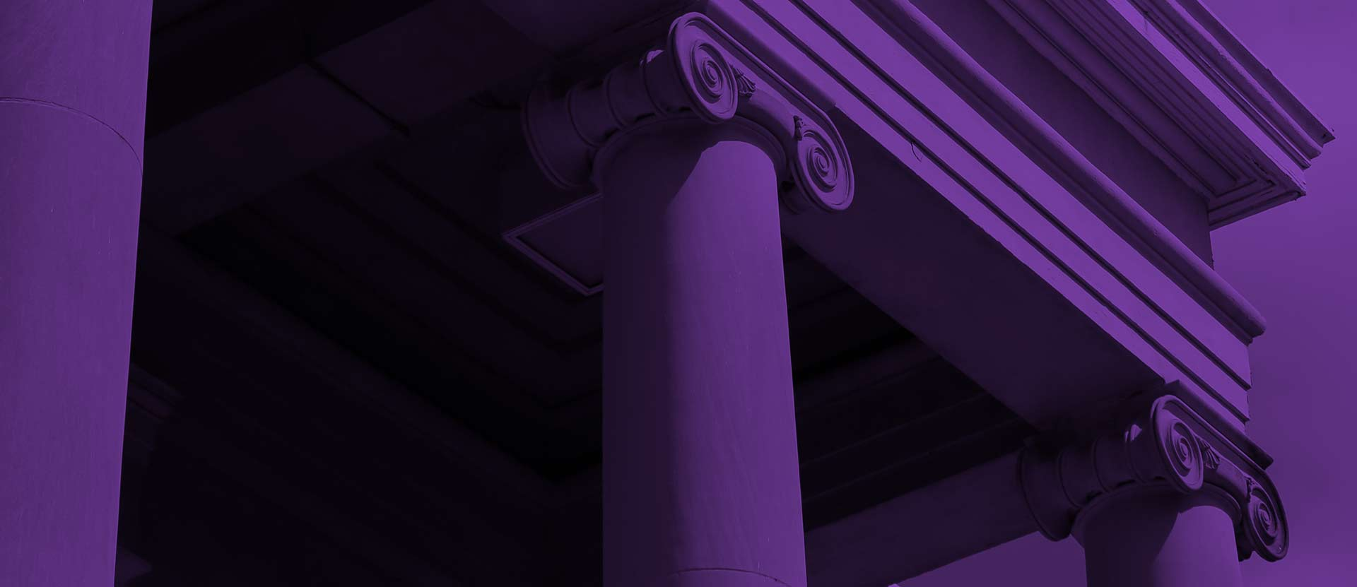 Columns of Candler building with purple overlay.