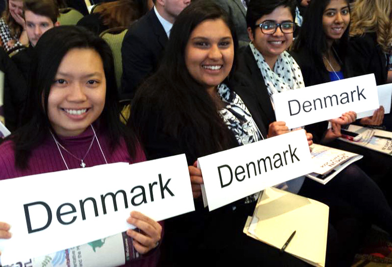 Model UN group with signs holding countries