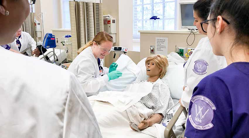 Student gets hands on training in Nursing lab.