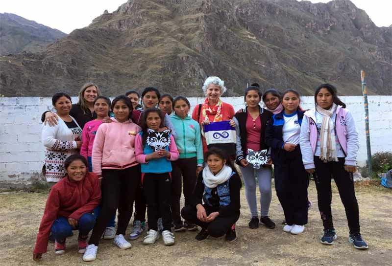 Alumnae with young women in Peru.