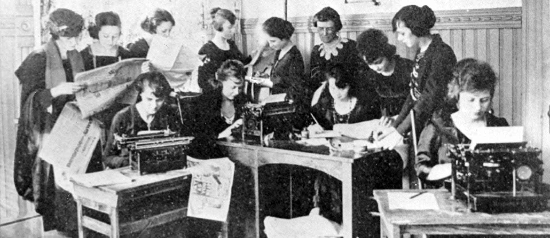 Wesleyan College students work on typewriters for the college newspaper.